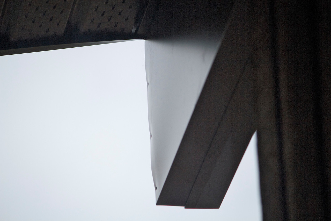 A fairly clear view of the effect of power stapling beam caps that do not fit correctly. Also, the bottom edge of the fascia appears to be bent down near the beam cap.