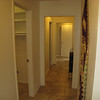 hallway leading to 3 bedrooms and full bathroom