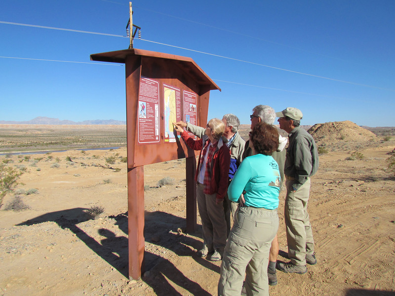 Which way do we go?  5 of them looking at the interpretive sign.