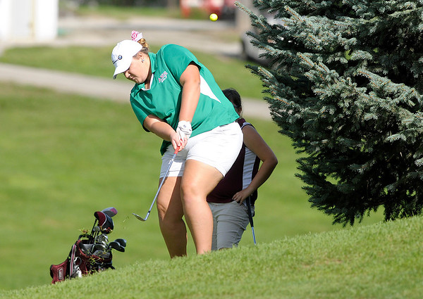 Anderson's Morgan Nadaline chips onto the third green.