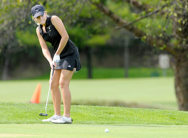 Meg Fields putts on the 16th green.