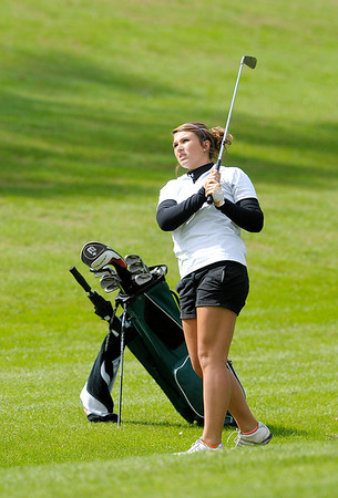 Pendleton Heights' Jordan Dean watches her approach into the 18th green.