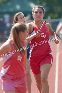 Julienne Devita (center) of CVU hands the baton to teammate Taylor Spillane in the 4x800 Meter Relay teammates as they set a state record at the Vermont High School Track and Field State Championship at Burlington High School on Saturday June 1st, 2013.