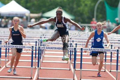 Mariah Neverett of Essex wins the 100 Meter Hurdles at the Vermont High School Track and Field State Championship at Burlington High School on Saturday June 1st, 2013.