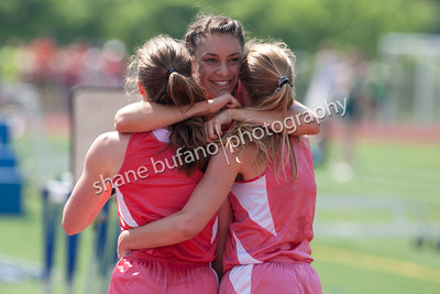 Julienne Devita (center) of CVU hugs her 4x800 Meter Relay teammates as they set a state record at the Vermont High School Track and Field State Championship at Burlington High School on Saturday June 1st, 2013.