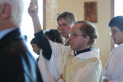 Fr. Bob blesses the new church with holy water.