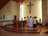 The start of mass in the new church.