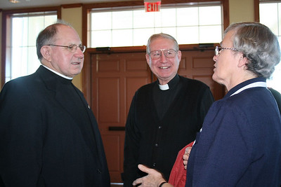 Br. Ray Kozuch and Fr. Leonard Elder talk with a parishioner.  Br. Ray helped to facilitate the combining of the two faith communities of Tunica and Walls.