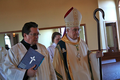 Fr. Jack and the bishop process in.