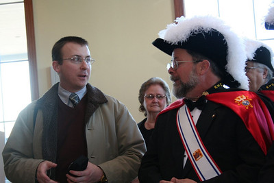 Frater Greg Schill talks with one of the Knights of Columbus