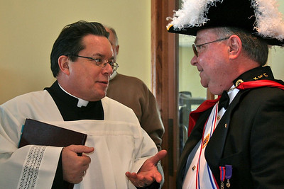 Fr. Jack Kurps, executive director of Sacred Heart Southern Missions and master of ceremonies for the dedication mass, speaks with one of the Knights of Columbus.