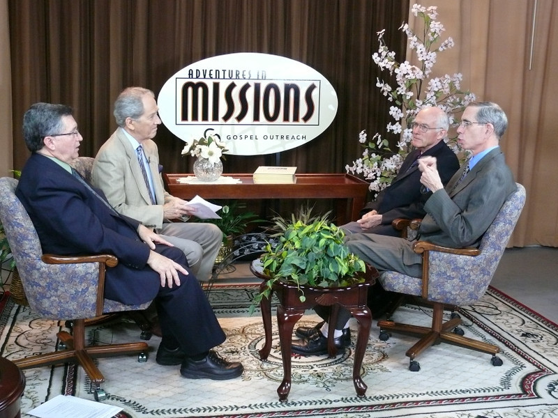 (L to R) Pat Bryant interpreting for Elder David Trexler - signing on the extreme right; Elder Dan Matthews Interviewer on the TV program, Elder John Blake, Deaf Ministry Director.