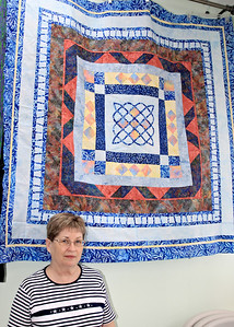 Judy Wilhite and Her Quilt