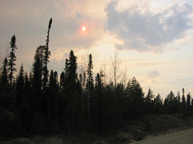 Red sun caused by the smoke of  forest fires raging West between Val-Dor & the Reservoir...<br /> <br /> Soleil rouge causé par la fumé venant des feux à l`ouest entre Val-Dor et le Réservoir...