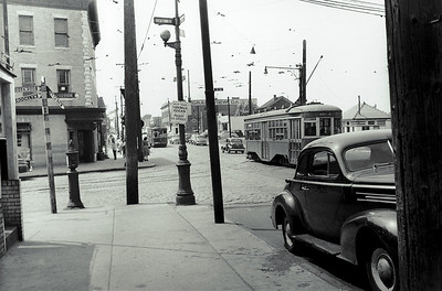 Metropolitan Avenue at Fresh Pond Road looking west. The only things that remain the same today are the fire call box, the telephone pole and the street light. The rest of the scene is completely different.