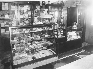 The candy display  Peppermint candies, licorice, chocolate, Life Savers, Charms and other sweets were as popular back in the 1940s as they are today. And if you didn't have a sweet tooth, you could always pick up a pretzel or cigar instead. Tobacco products line the wall shelves behind the display case. Note the wooden phone booth in the corner. When was the last time you sat in one of those?