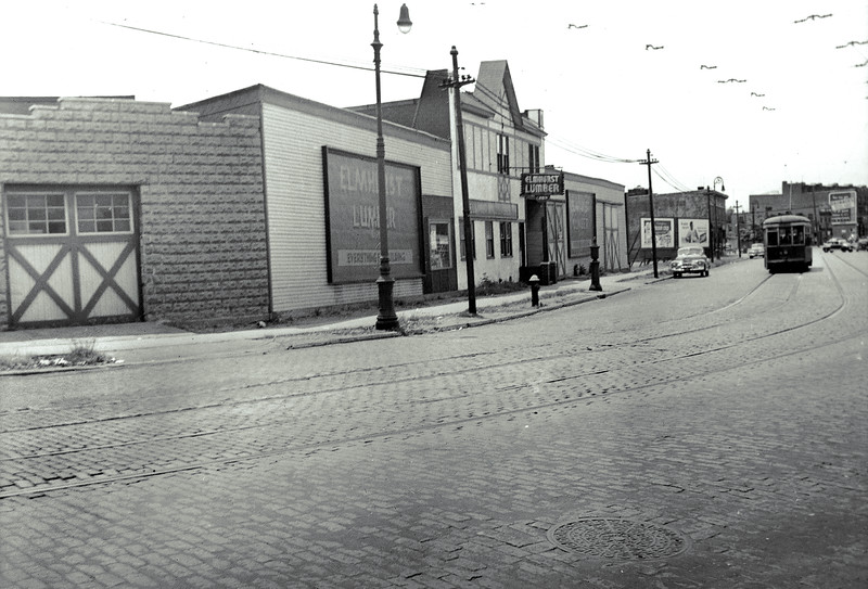 The Elmhurst Lumber Corporation owned a large parcel of land on the south side of Grand Avenue (and the north side of 57th Avenue) between 72nd and 74th Streets. Today, everything in this picture has been replaced by P.S. 58 - The School of Heroes.