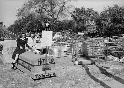 Maspeth women at recycling drive, 1942.  During World War II, Maspeth women did their patriotic duty by growing victory gardens, buying war bonds and collecting scrap metal to recycle into weapons for the troops. One location for the scrap metal effort was a commercial yard located at Metropolitan and Flushing Avenues, depicted here.