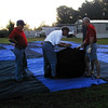 Martin Gas employees help unpack the Propane Exceptional Energy Hot Air Balloon envelope.