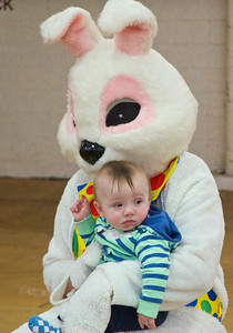 Skip Traynor - Special to the Sun Max Moore, 7 months of Mt. Pleasant, seems unimpressed with his visit with Peter Cottontail at the Great Egg Scramble in Central Michigan University's Finch Field House Saturday, April 12, 2014. The scramble sponsored by Mt. Pleasant Parks and Recreation and WCFX radio station with help from CMU student volunteers featured games, crafts, a visit with Peter Cottontail and a rush to find candy.