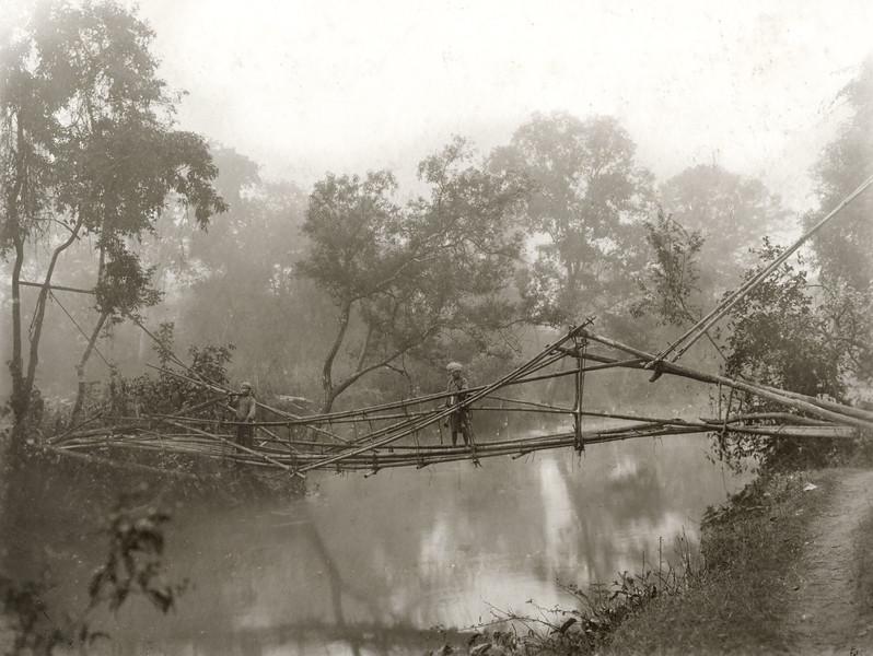 """A typical bamboo bridge over the Nam Hang."""