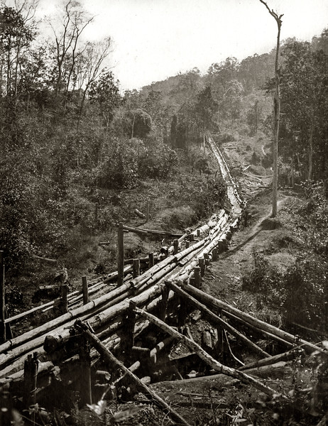 """Looking up the steep part of the chute (1/2 mile( from the more or less level section. The second bridge over the H Kan."""