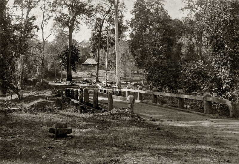 """""Bridge over the H Hom close to the capstan. The H Hom bungalow and the begining of the road over the hill are seen in the background."""