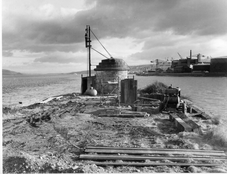 T013Excavation for mooring point D Navigation Light, Gas tank and Stone Tower in background   31/12/1962