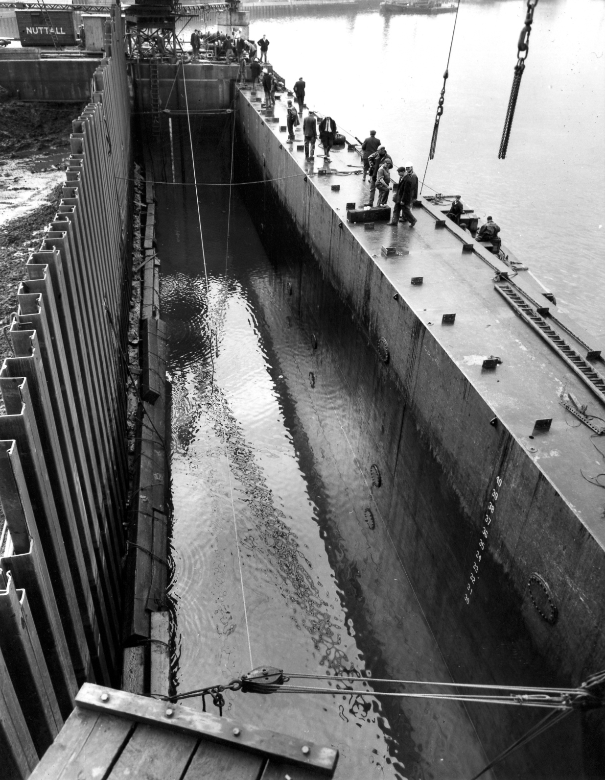 D103Dock Gate - stepping just completed - dewatered to -12 S.D.   Sept 1963