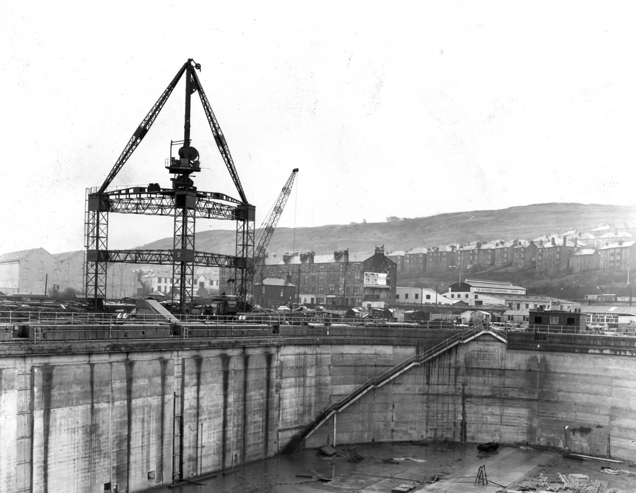 D128	Arch staircases completed - erection of 15 ton crane commenced  3/2/1964