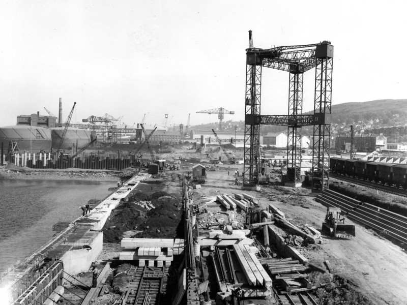 Q024Laying rails and filling up to surfacing level. Butters derrick gabbards in background  30/5/1963
