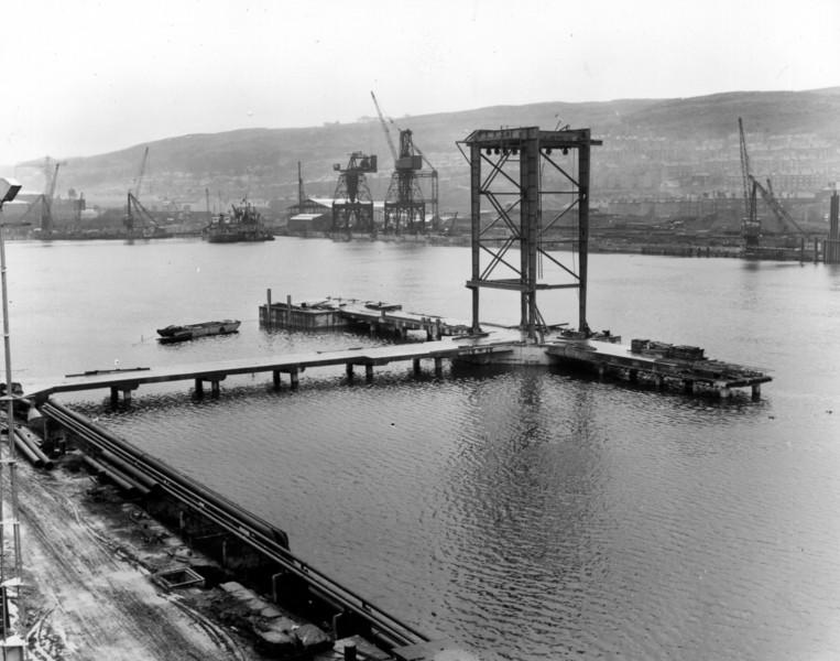 T033	View of tanker jetty looking south east  30/12/1963