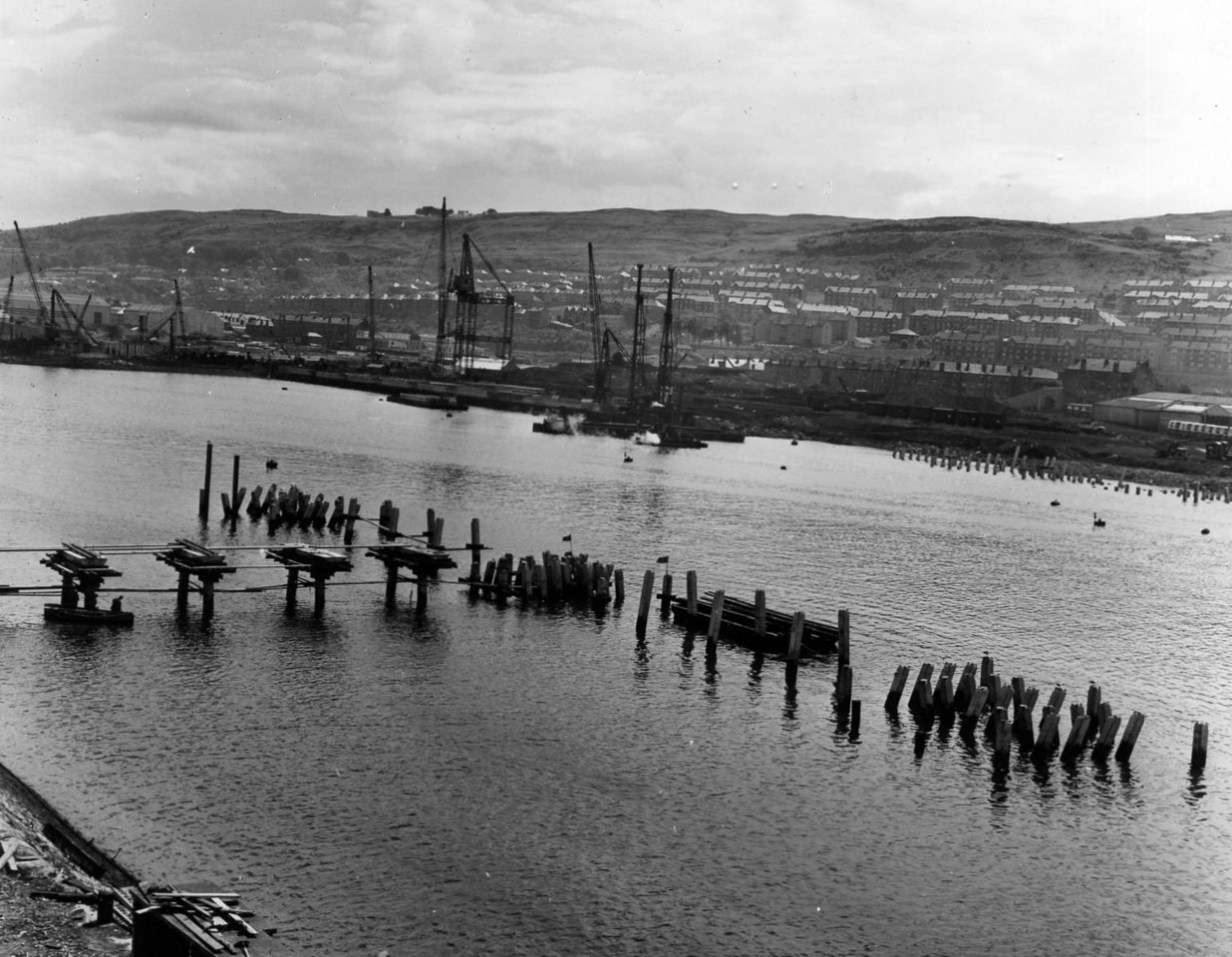 T025	View of tanker jetty looking east  26/6/1963