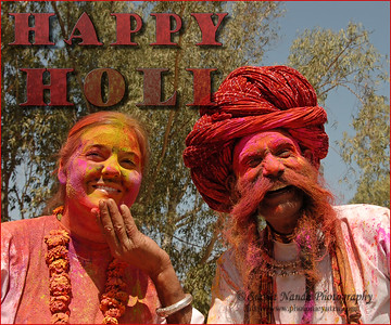Tourists and foreigners enjoying themself. Holi the Festival of Colours being celebrated in Jaipur, the Capital city of Rajasthan, India.