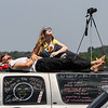 Mary Ludwig, 14, looks up at the Sun with family friend Jonathan Billing as they sit on top of Billing's truck and observe the Great American Eclipse of the Sun at Orchardale Farm in Cerulean, Ky, on Monday, Aug. 21, 2017.