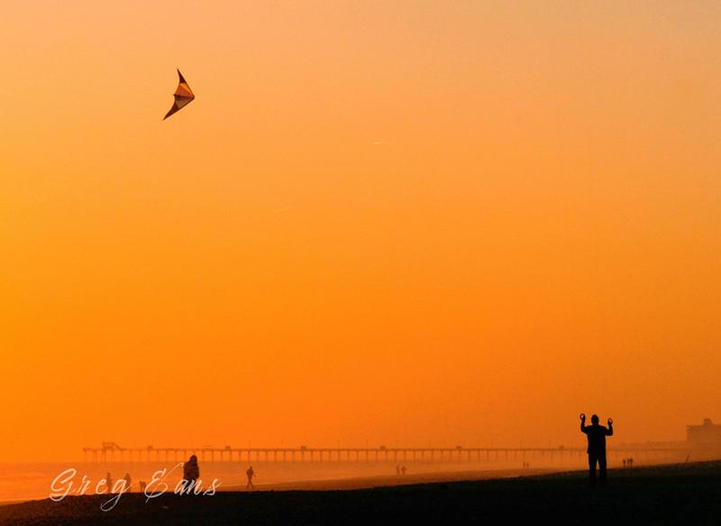 Flying a kite on the beach at sunset.  Emerald Isle, North Carolina.