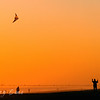 Flying a kite on the beach at sunset.  Emerald Isle, North Carolina.