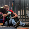 "<i>Hurricane Katrina, 2005</i>: Kathy Kennedy, who came from California to help animal rescue efforts in a shelter set up in Jackson, Mississippi, enjoys a moment with an Lab Mix with which she has become attached, Saturday, September, 10, 2005, in Jackson, Mississippi.  ""He survived 37 feet of water for several days"", Kennedy said.   The Shelter has been set up by The United Animal Nations Emergency Animal Recue Services at the fairgrounds in Jackson. (Greg Eans/Associated Press/Cox Newspapers)"