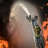 A Greenville (NC) Fire-Rescue Firefighter makes his way up a ladder while battling a blaze at the historic Imperial Tobacco Warehouse.