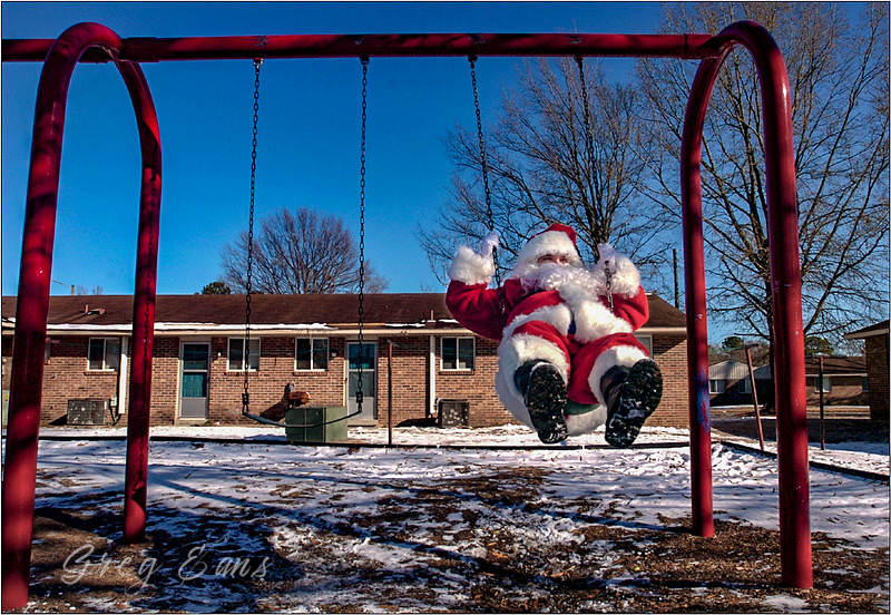 Santa Claus found swinging on a swing set. North Carolina.