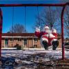 Santa Claus found swinging on a swing set. North Carolina.
