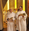 Clint Landry of the Diocese of Fairbanks and Greg Schill, SCJ, enter the chapel.