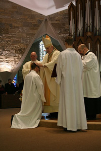 The bishop places his hands upon Greg