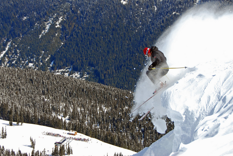 Jumping off a cornice in Harmony Bowl on Whistler Mountain in British Columbia, Canada