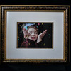 NFS: Here is an example where I took one of the beautiful frames, removed the photograph and inserted a favorite portrait of my granddaughter.