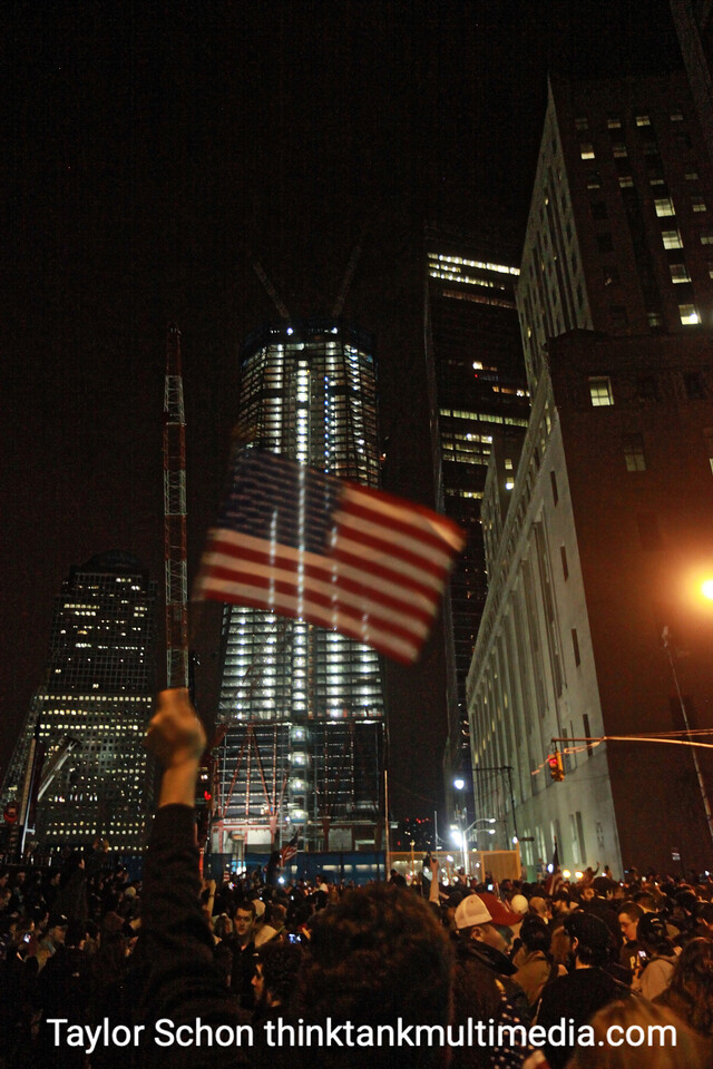 Crowds amass and celebrate with the ever rising One WTC construction in the background.
