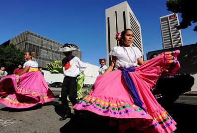 Guadalupe Day - Downtown San Diego: Picture shows: Alexa Murillo, right and Luis Aguirre, center, from the group Ballet Folklorico Tapatio de San Diego.