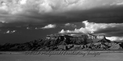 """Ominous Canopy"" in black and white Guadalupe Peak, as seen from the Salt Flat are of Texas, after a heavy rain."