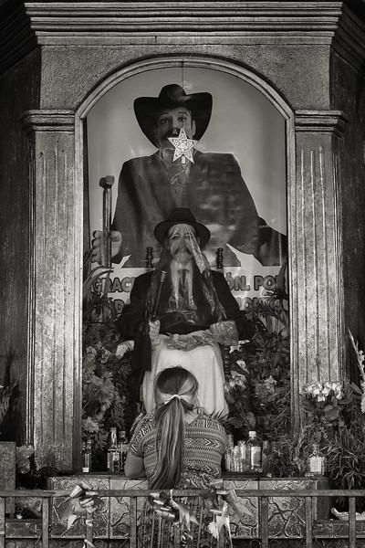 Pilgrim Praying at the Alter of St. Simon (Maximón), San Andrés de Itzapa, Guatemala