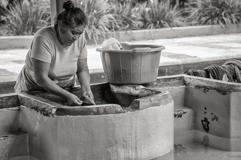 Woman Washing Clothing at Communal Laundry, Guatemala